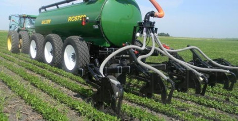 Fertilizer injector vehicle working on cropland.